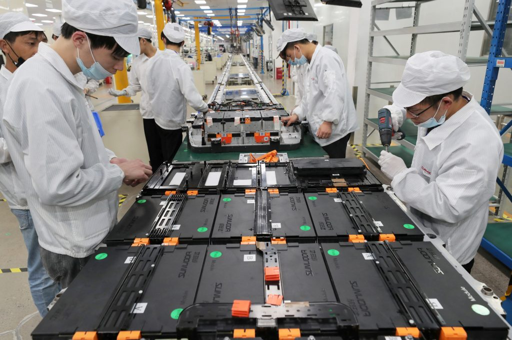 Workers making lithium ion batteries for electric cars
