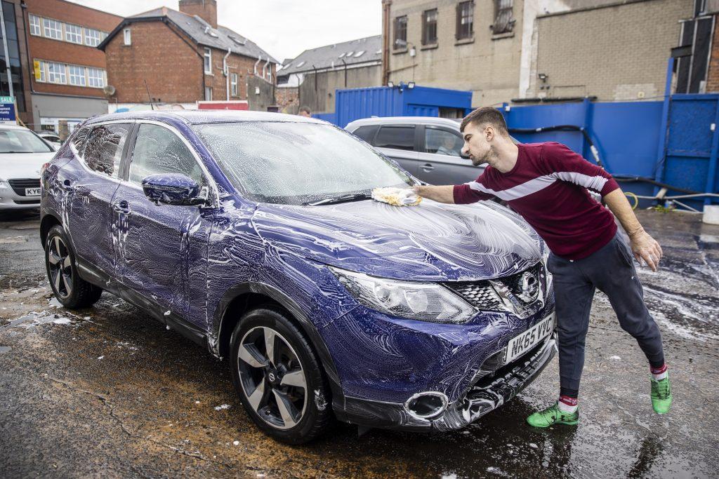 A man detailing a car in Belfast