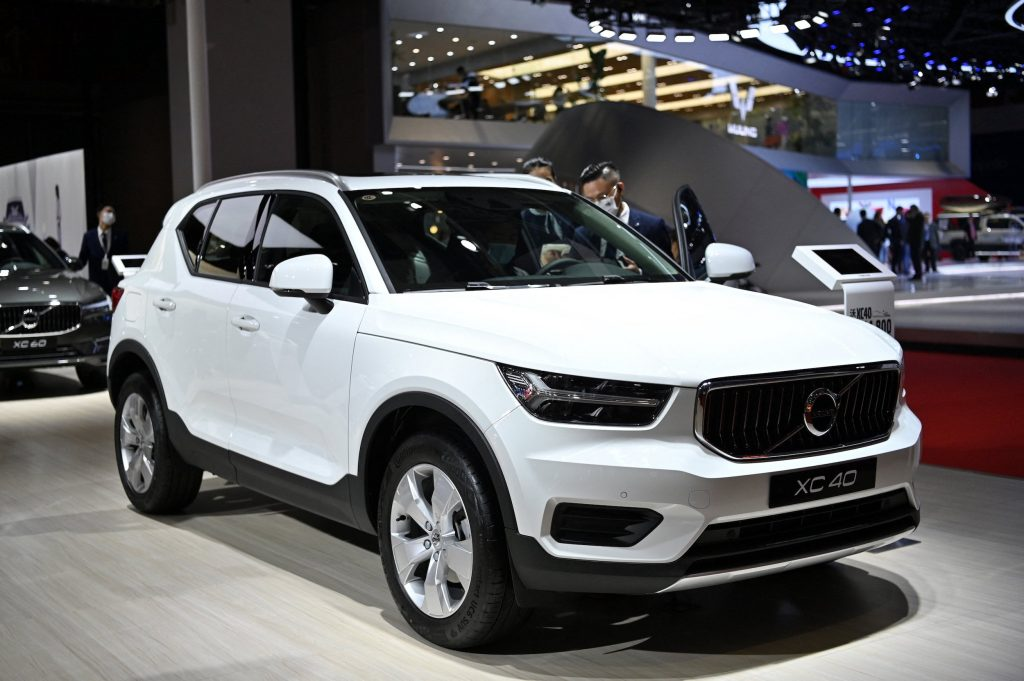 a white 2021 Volvo XC40 at an auto show on display