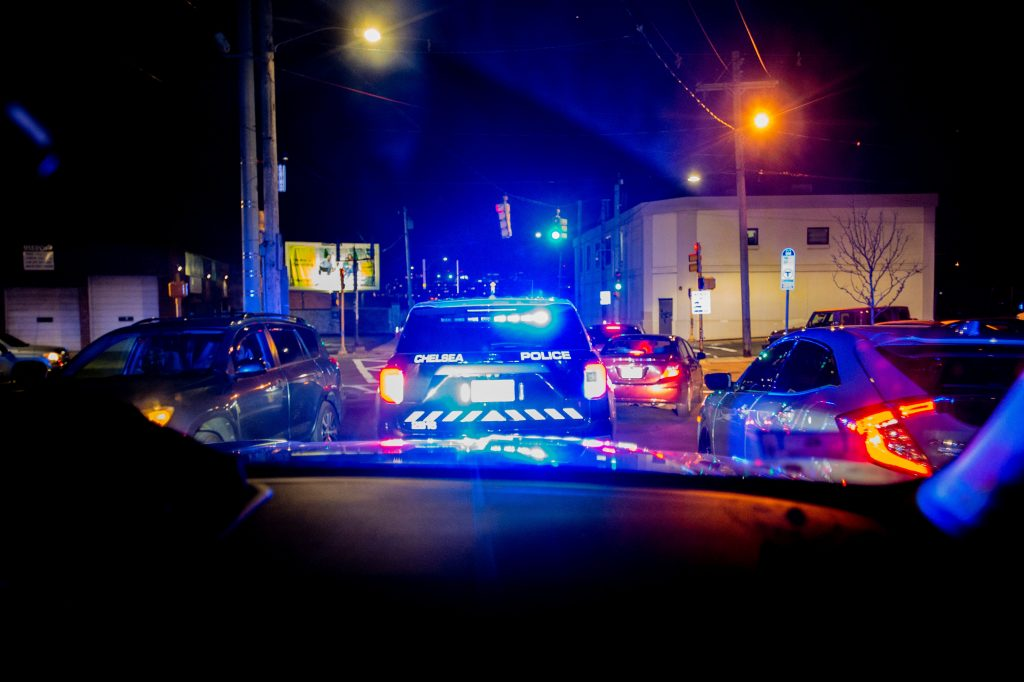 Police cars on a traffic stop at night