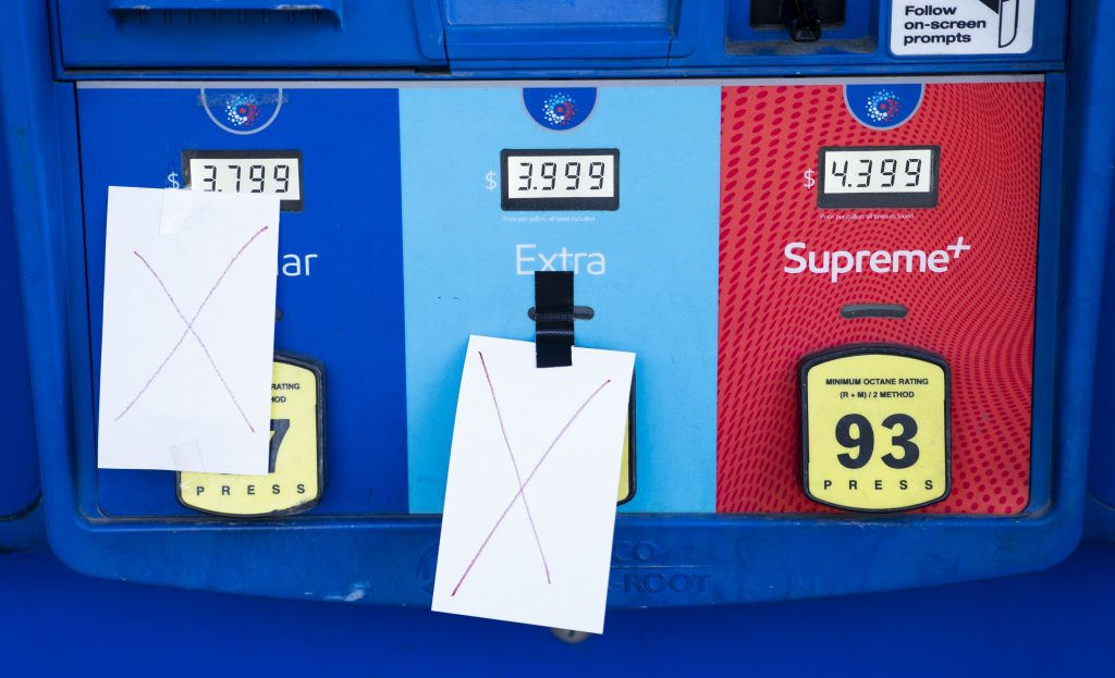 A pump showing $4.33 for a gallon of premium gas