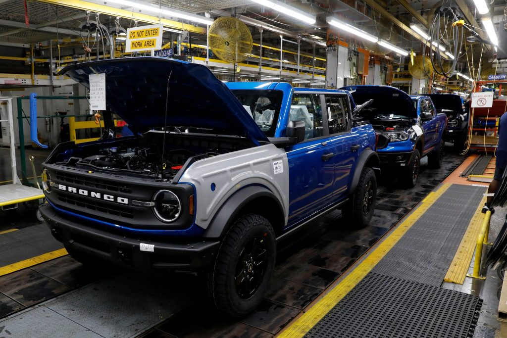 A four-door blue hardtop Ford Bronco on the production line in Michigan