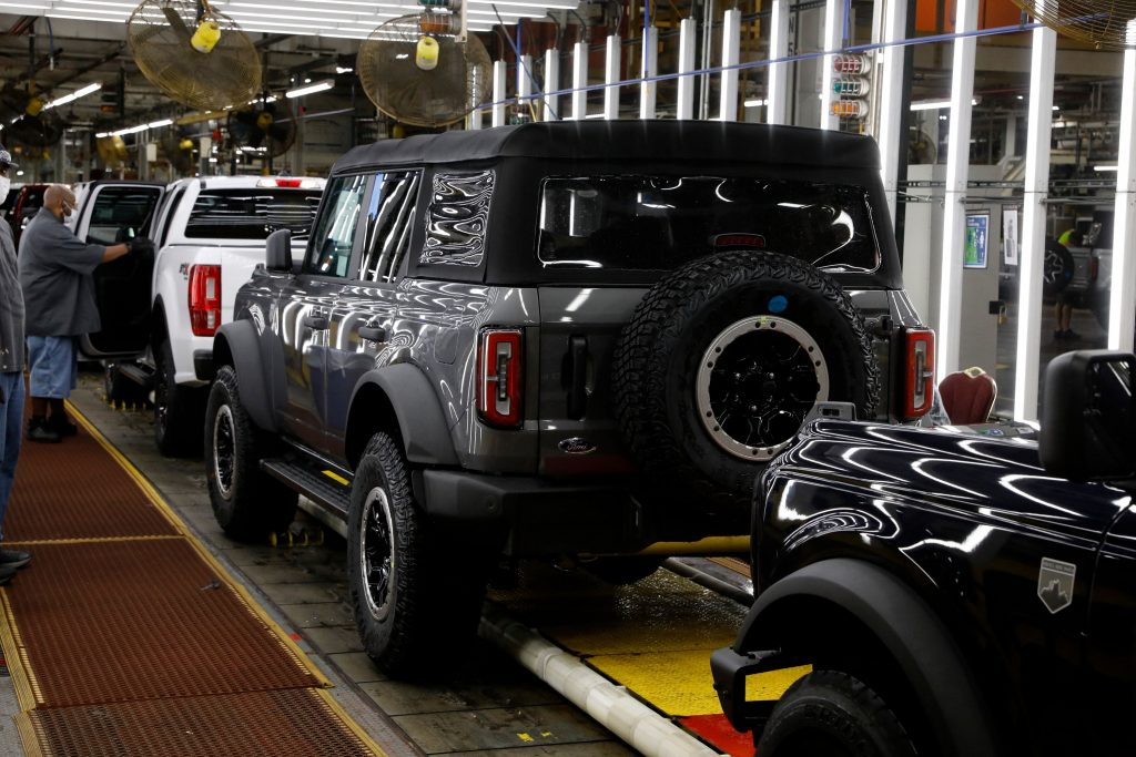 A four-door grey soft-top Ford Bronco on the production line in Michigan