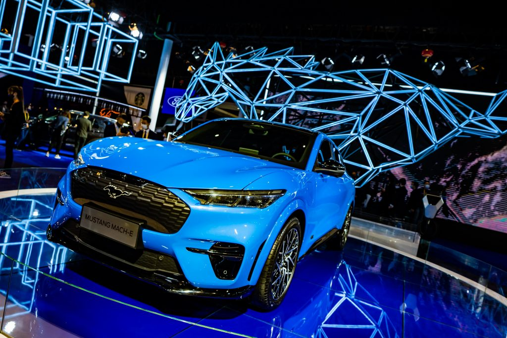 An electric blue Mach-E at an auto show in China