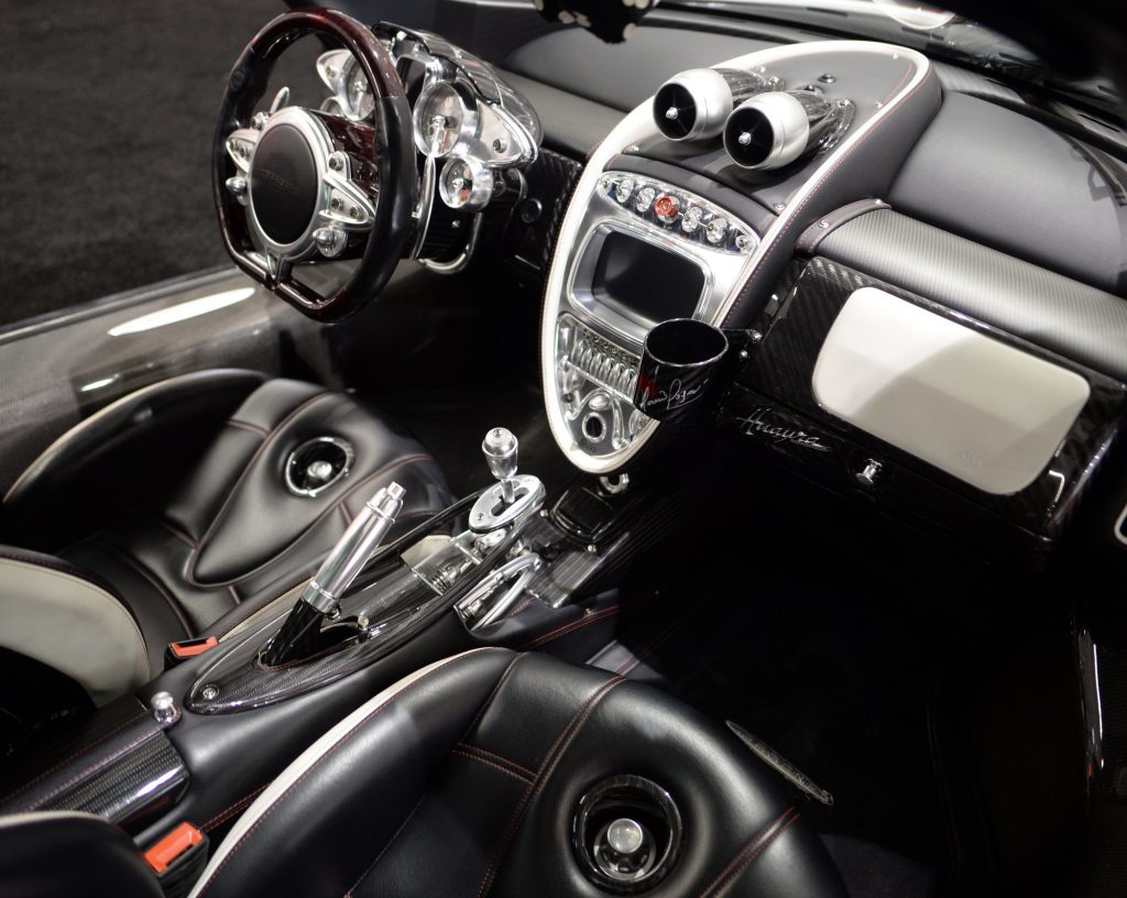 The beautiful but weird interior of the Pagani Huayra, covered in milled aluminium and carbon fiber