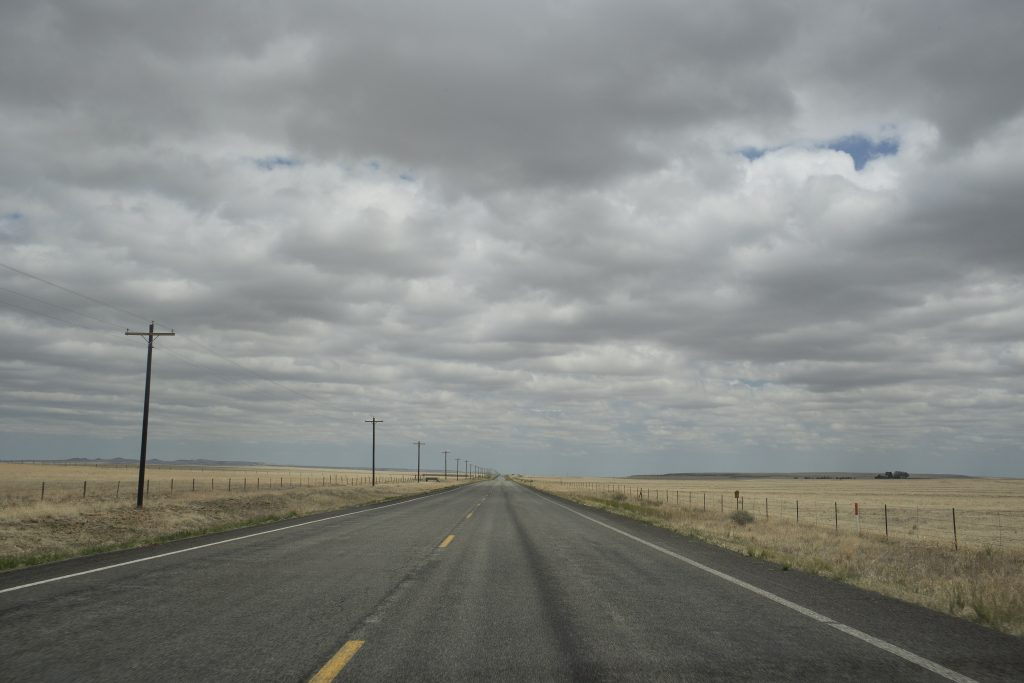 An empty, straight road in New Mexico