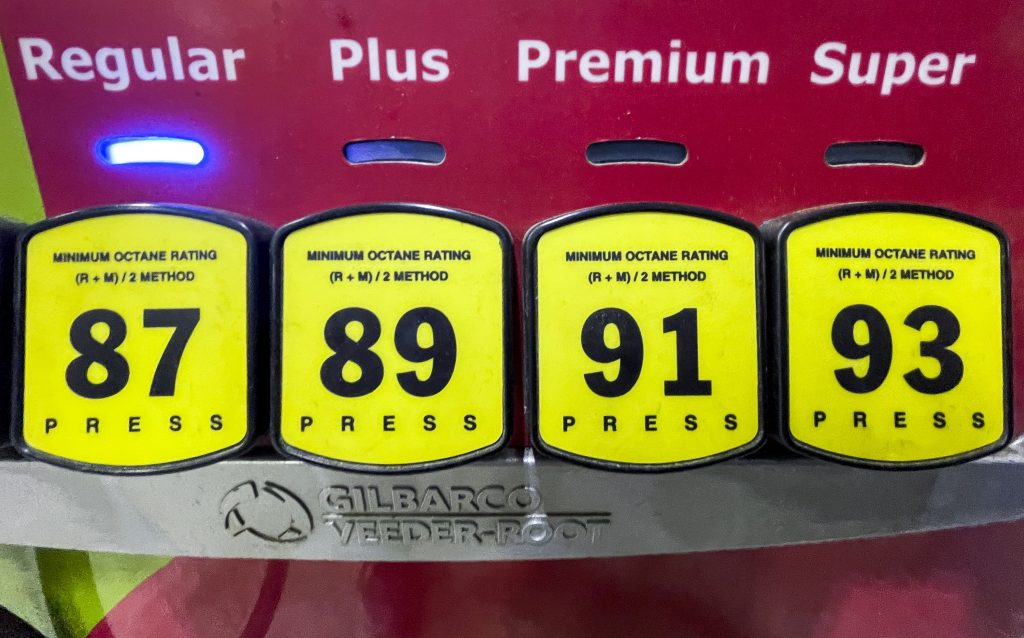 Gas prices are displayed at a pump