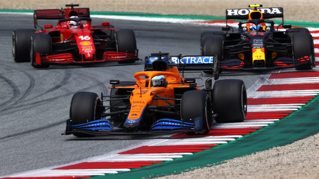 Daniel Ricciardo, Sergio Perez, and Charles Leclerc racing at the Austrian Grand Prix