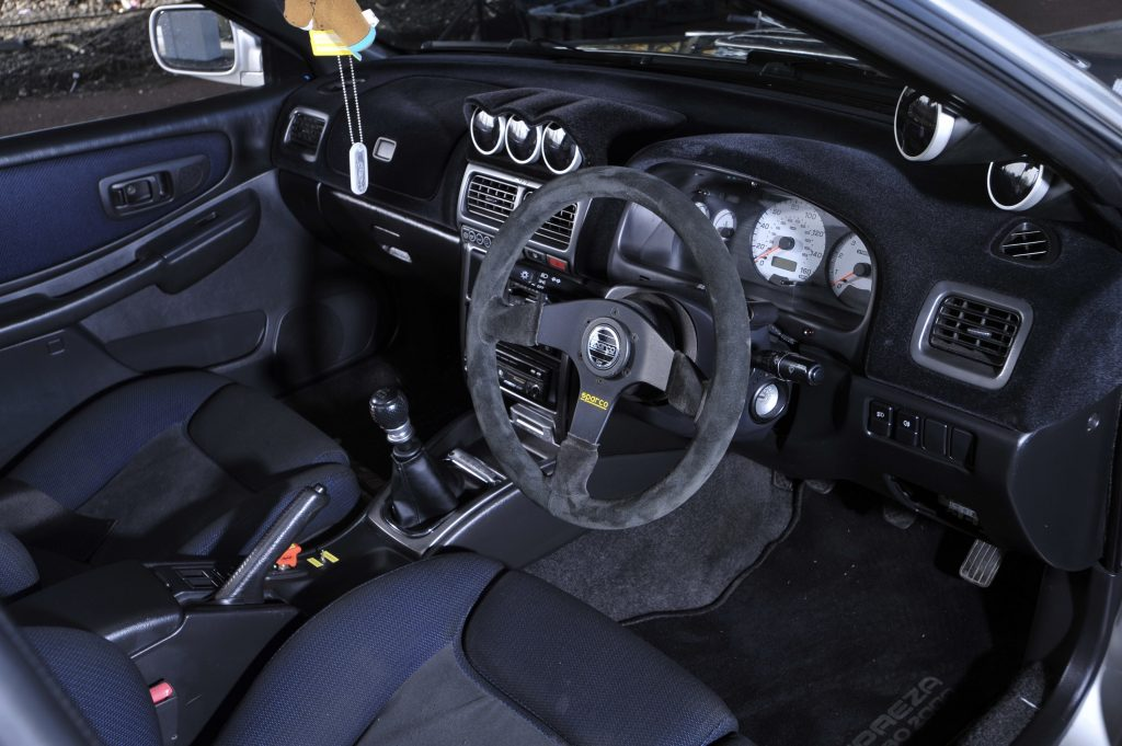 Subaru interior with the steering wheel on the right side of the car