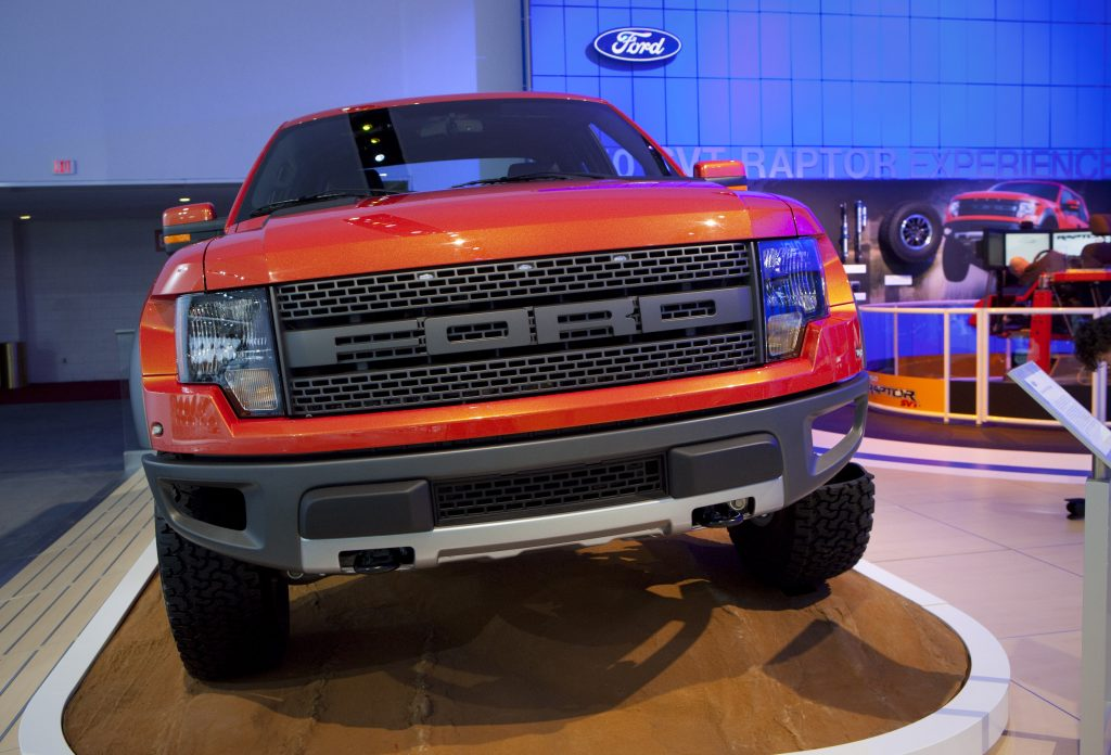 An orange Ford F-150 Raptor in 2009 ahead of its debut at an auto show