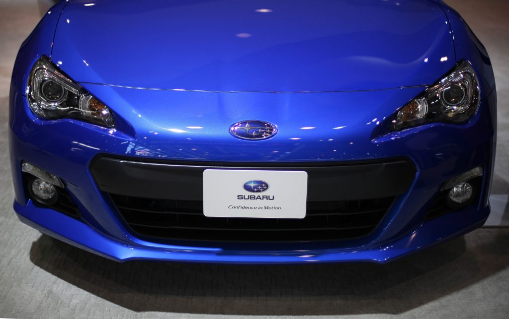 A the front end of a blue Subaru BRZ