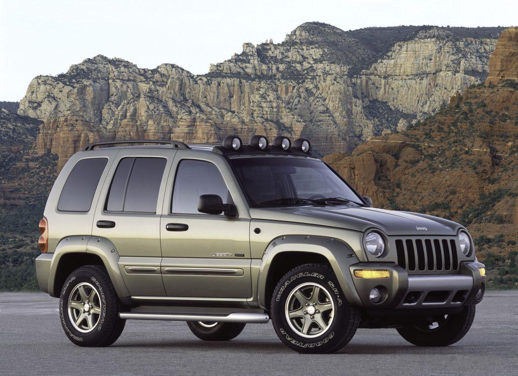 A silver 2003 Jeep Liberty Renegade on a mountain pass