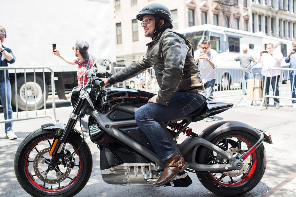 A man sits on Harley' latest electric motorcycle: the Livewire