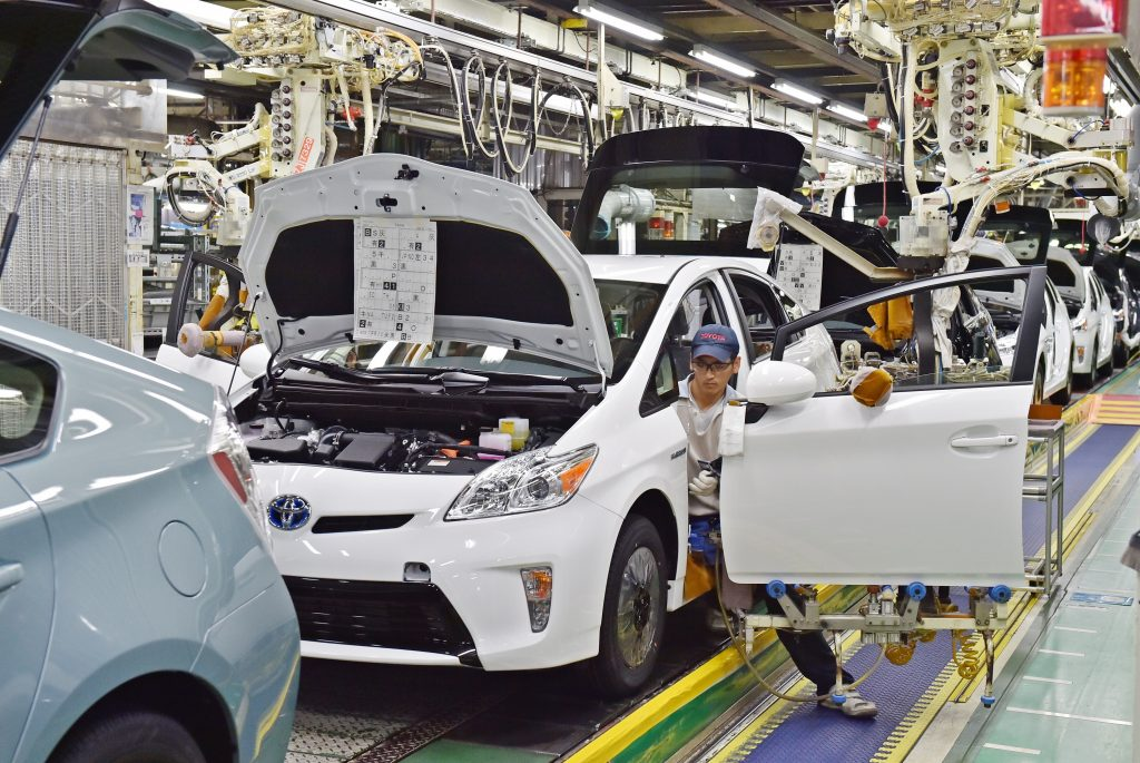 A line of Prius hybrids on the production line in Japan.