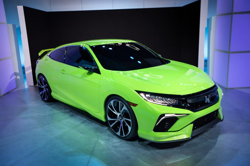 A very bright green Honda Civic Coupe