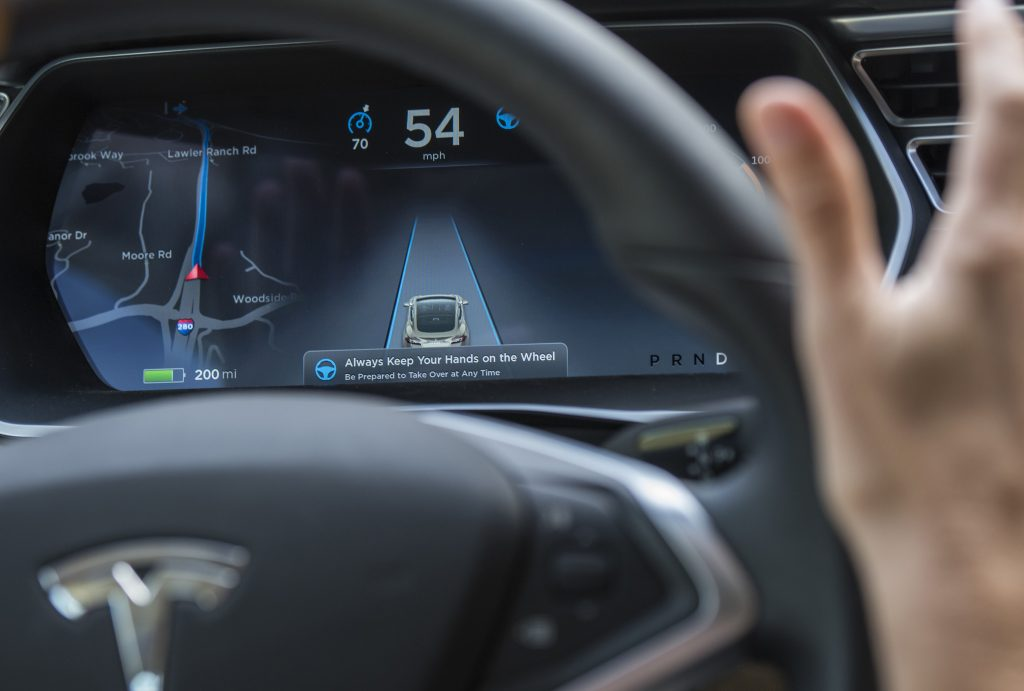 The display of a Model S sedan while Autopilot is active.