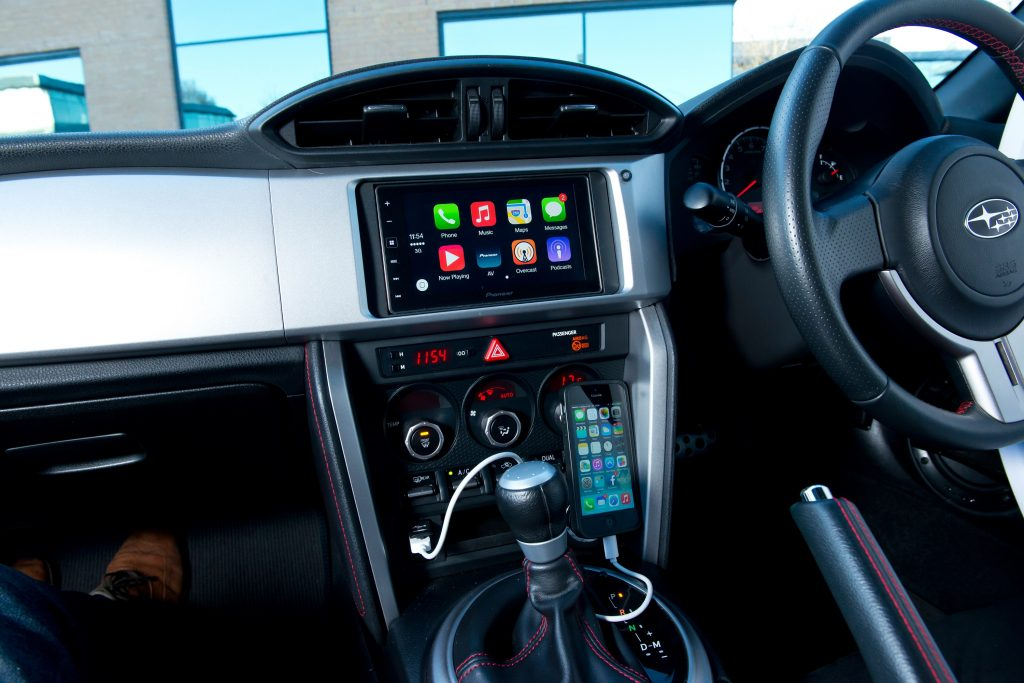 The BRZ's interior, complete with manual transmission and Apple Carplay