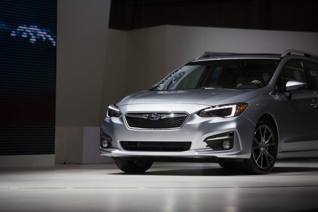 A silver Subaru Impreza wagon on stage at the N.Y. Auto Show