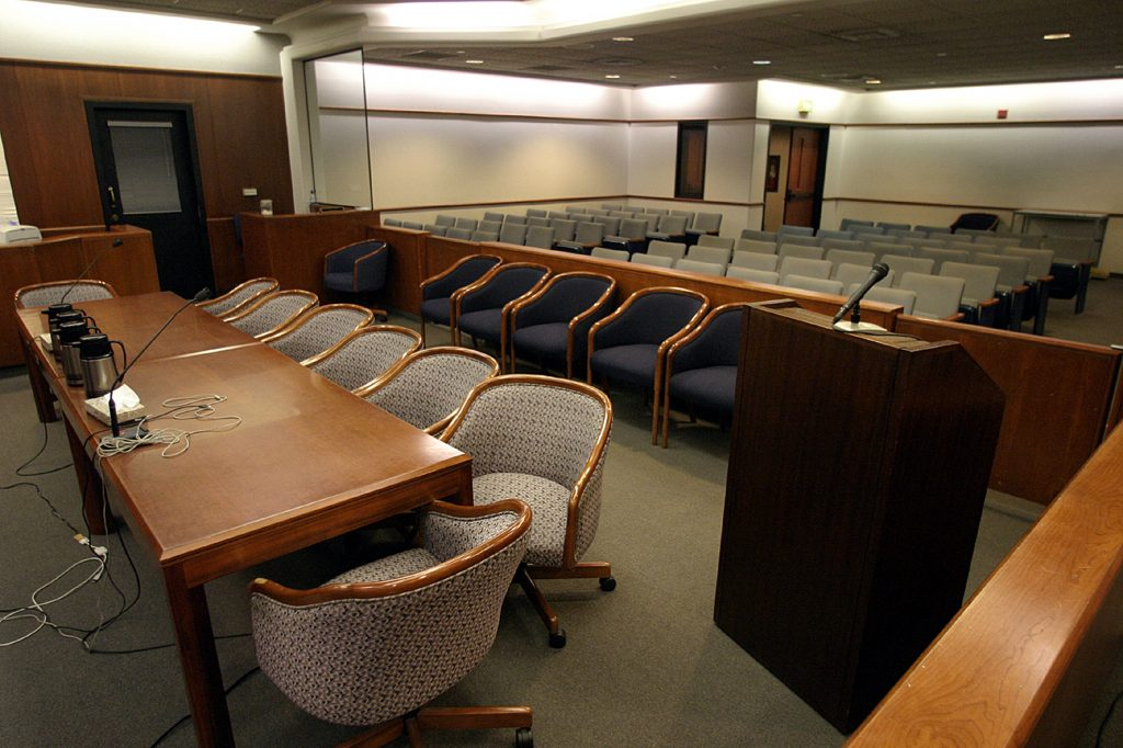 An empty courtroom, like the one you'll likely see should you fight a speeding ticket