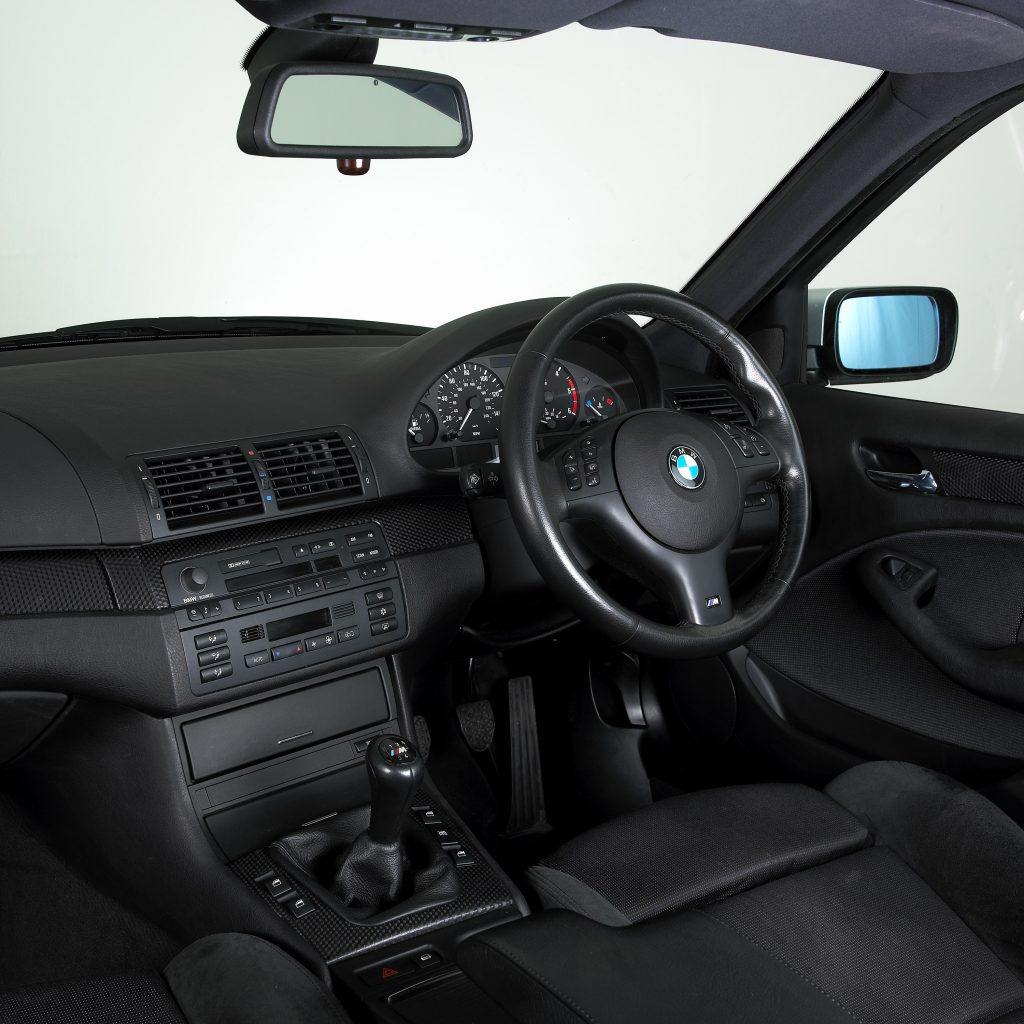 The interior of an E46 3-series BMW, which had nearly all of it's controls in the center.