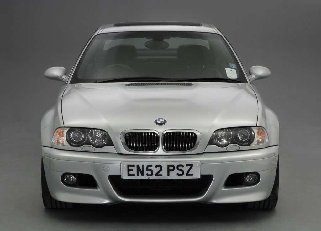 A silver 2002 M3 coupe shot from the front