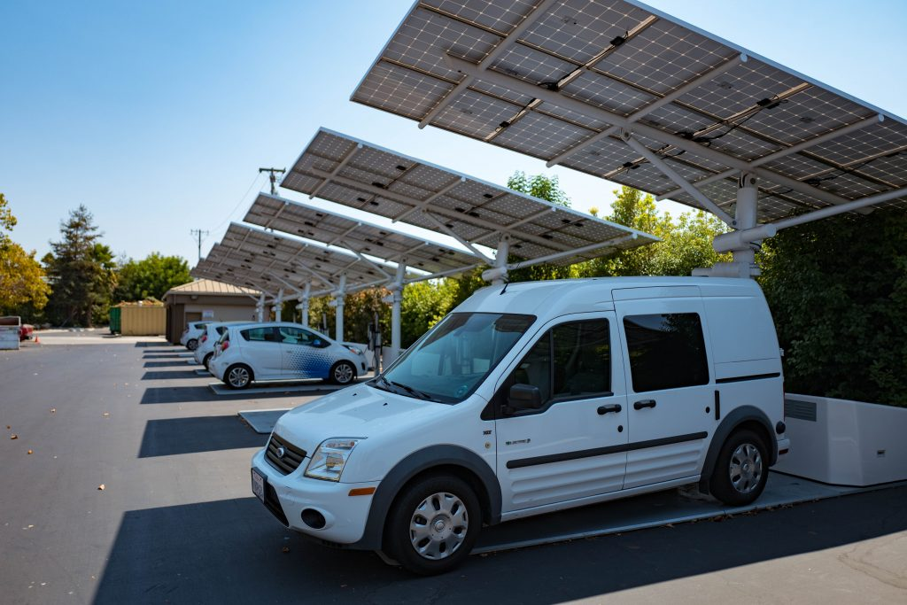 EVs and Hybrids plugged into a solar car charger.