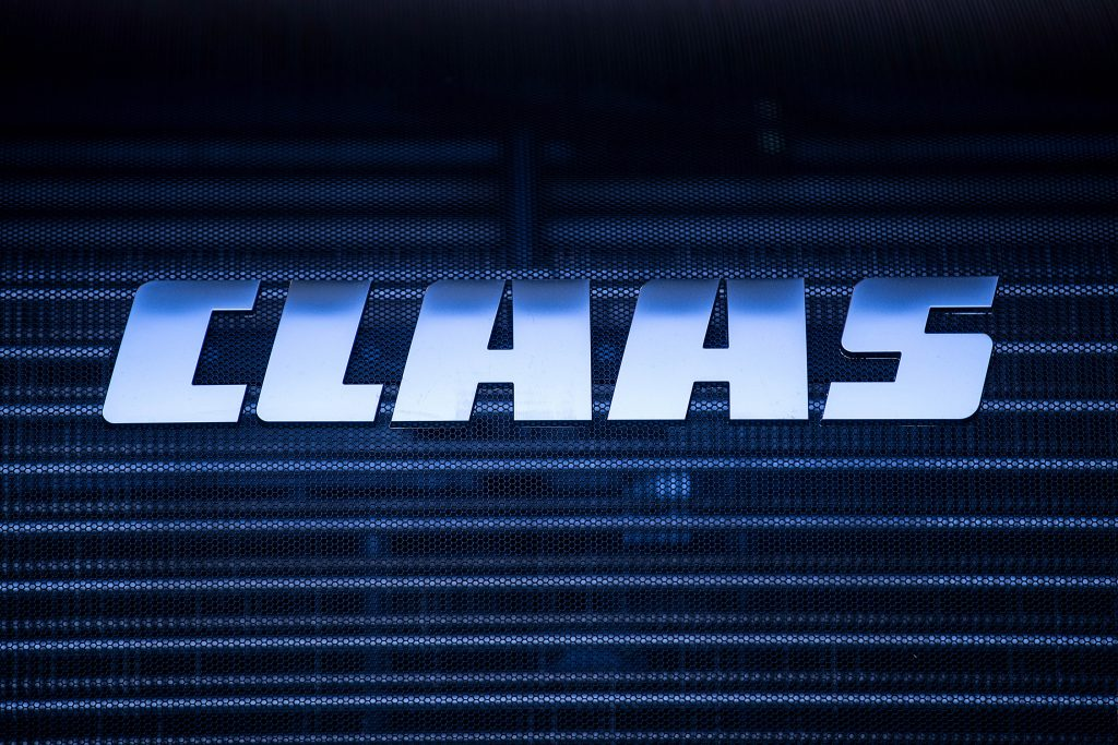 the Claas logo on the grille of a tractor