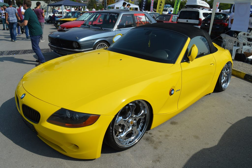 A yellow-wrapped BMW coupe