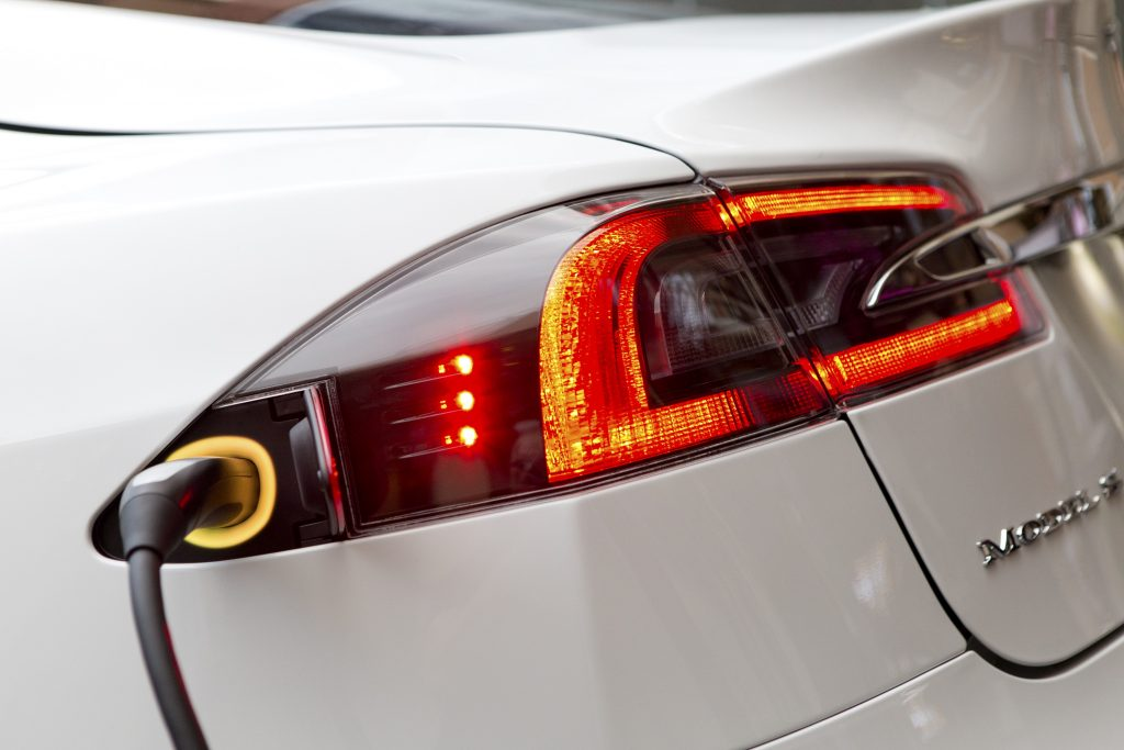 A closeup of a white Model S sedan charging in Germany