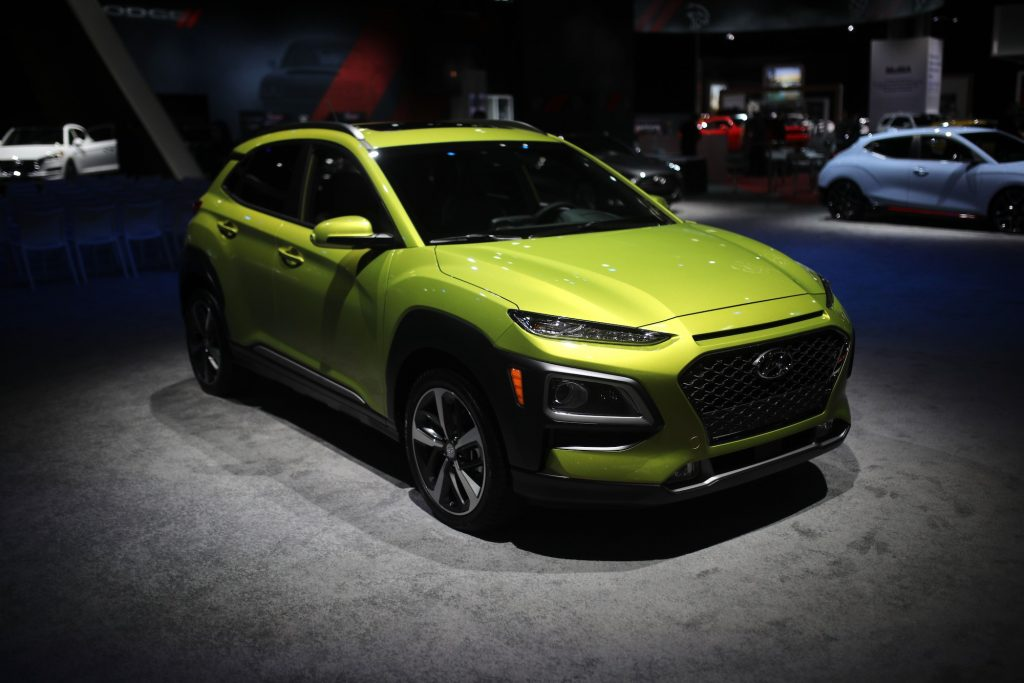 a lime green 2018 Hyundai Kona on display indoors.