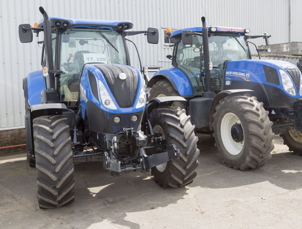 two New Holland tractors side by side at a dealer