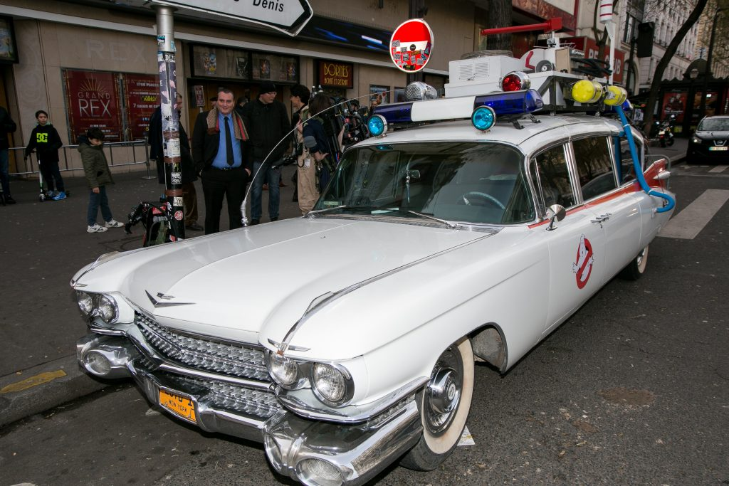 ecto 1 parked in front of a theater