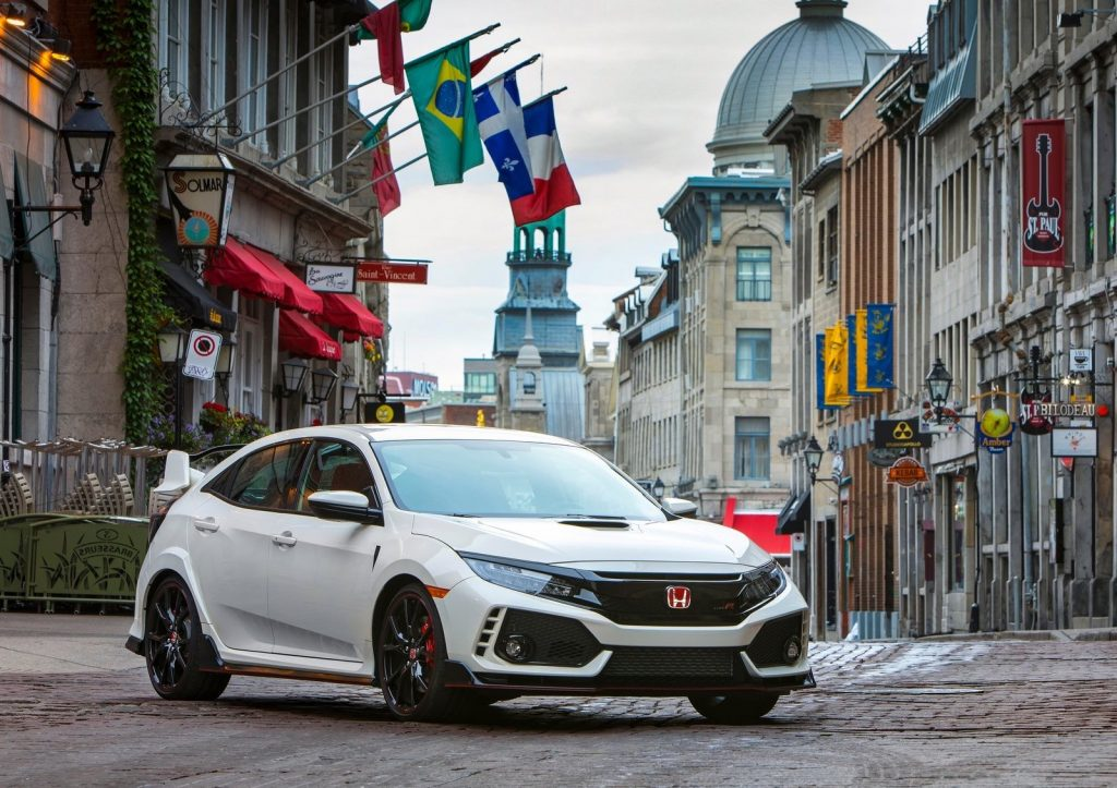 a white Honda Civic Type R in the city