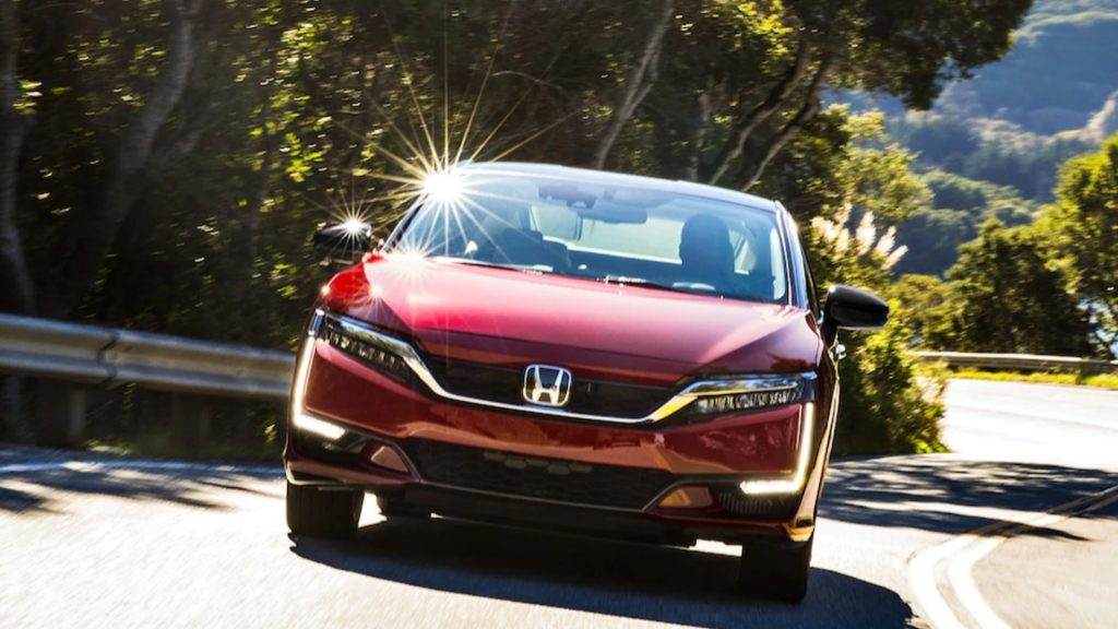 A red 2021 Honda Clarity Fuel Cell hydrogen vehicle.