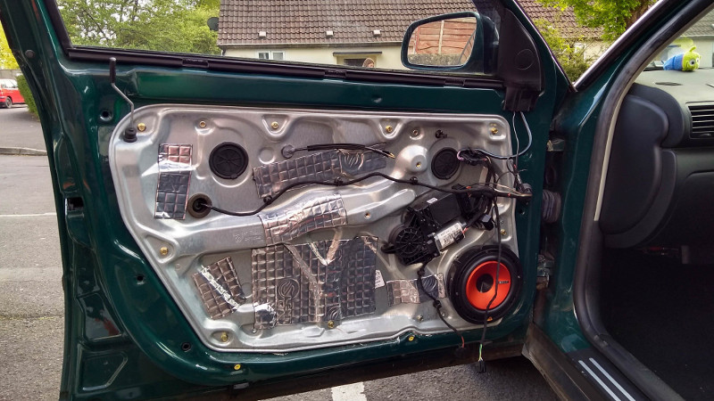A car where sound deadening material was added to the door panel.