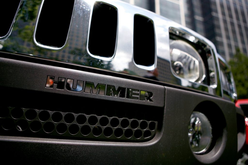 Close shot of older Hummer grille with Hummer spelled out under the main part of the grille.