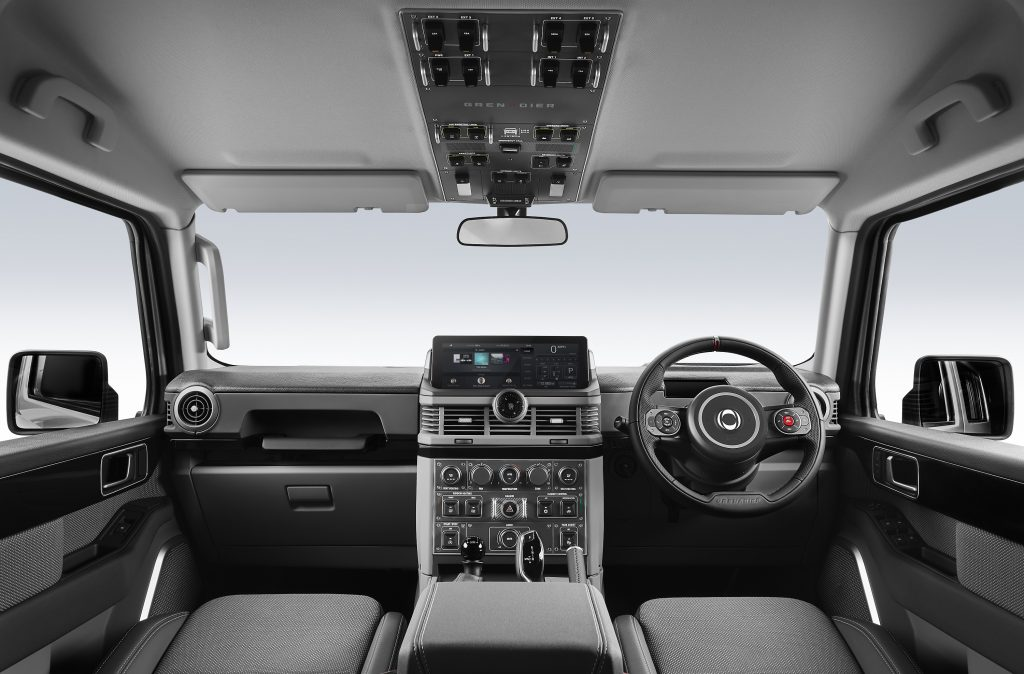 The interior of the new Ineos Grenadier, with aircraft-like switches on the ceiling
