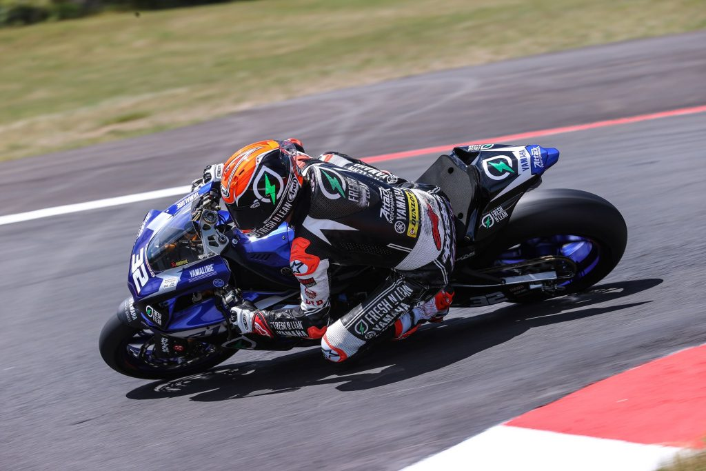 Jake Gagne taking his blue MotoAmerica Superbike Yamaha R1 around the corner of a racetrack