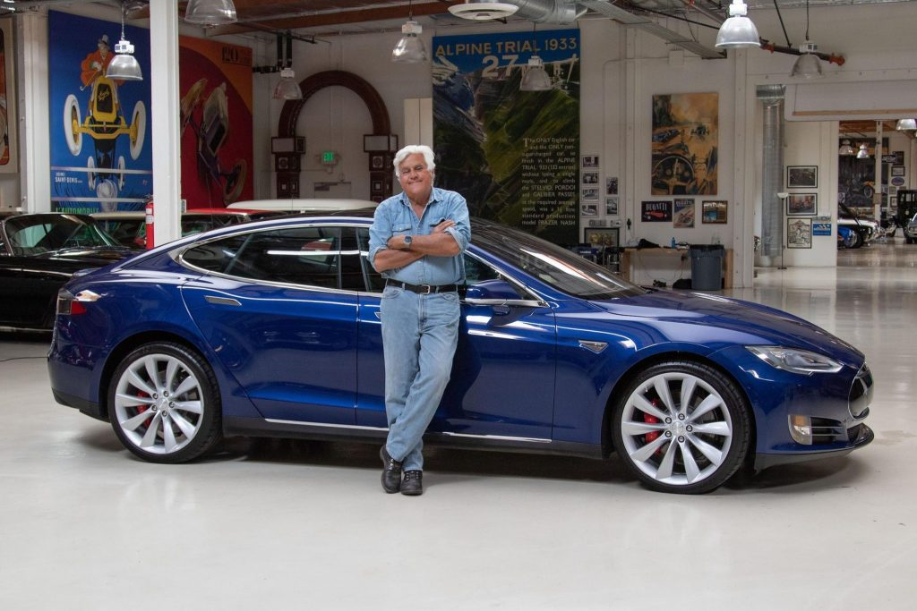 Jay Leno with his blue Tesla Model S