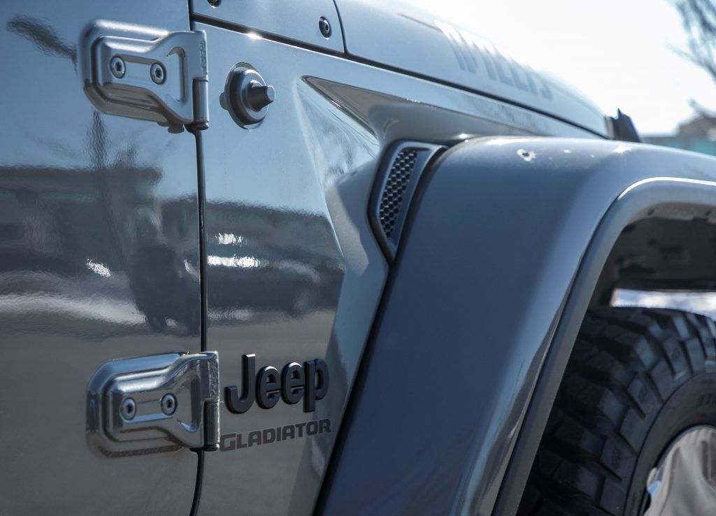 The badging of a Jeep Gladiator pickup truck