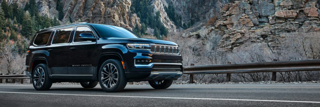 The Jeep Grand Wagoneer SUV model parked on a mountain highway