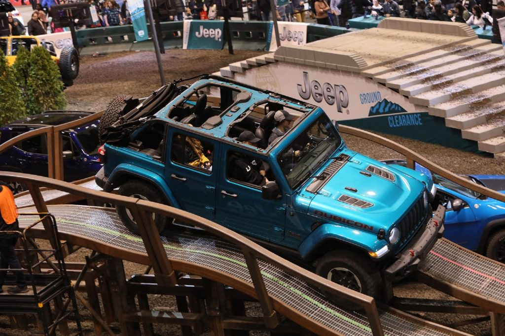 A turquoise-blue Jeep Wrangler Rubicon on the 2020 Chicago Auto Show's off-road test course