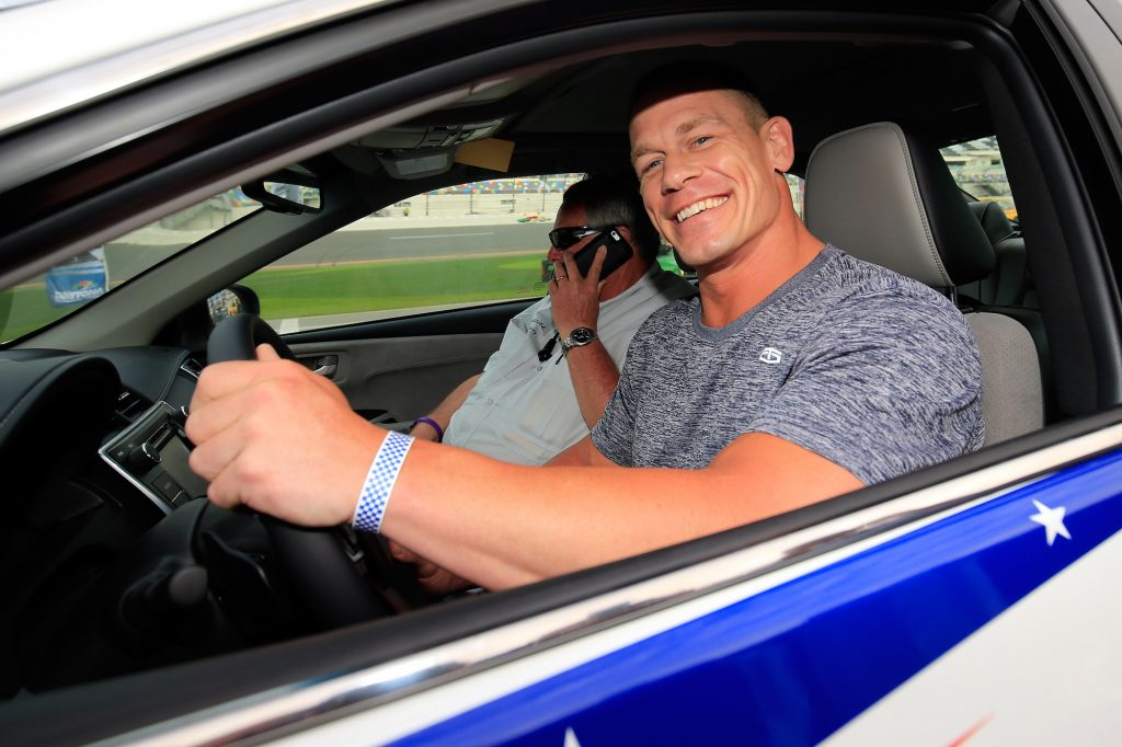 John Cena poses with the pace car before the Daytona 500 at Daytona International Speedway on in February 2016