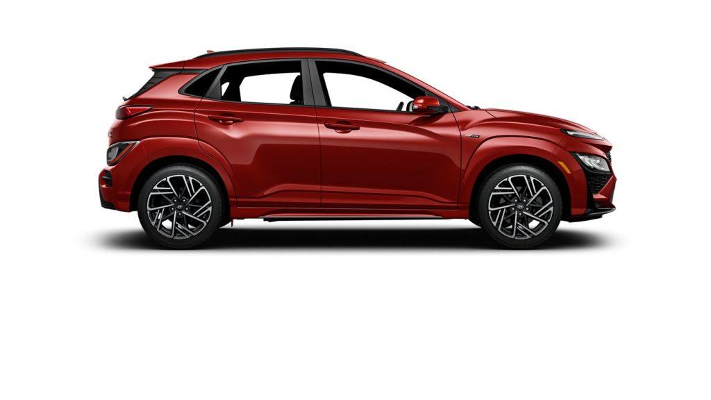 A red 2021 Hyundai Kona against a white background.