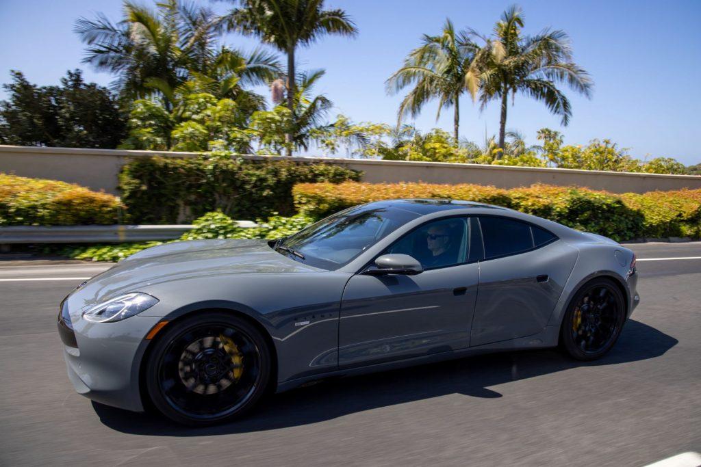 The Karma GS-6 luxury sports car driving near palm trees