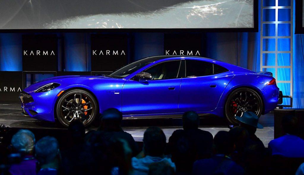 A bright-blue metallic Karma Revero GTS sports sedan at the Automobility LA Technology Pavilion in November 2019