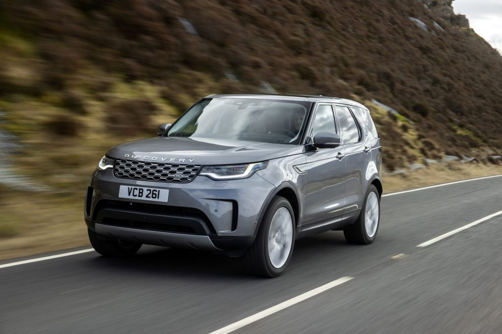 The Land Rover Discovery MHEV model driving on a country highway