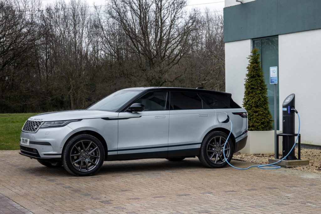 A Land Rover Range Rover Velar PHEV model connected to a charging station