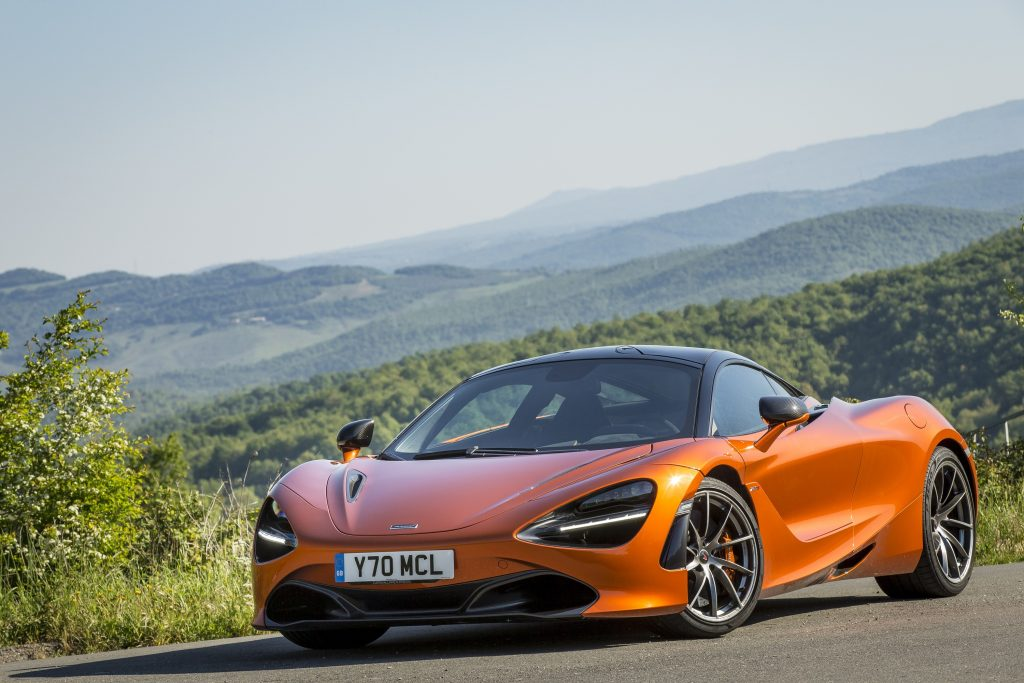 The orange Mclaren 720s on a country road