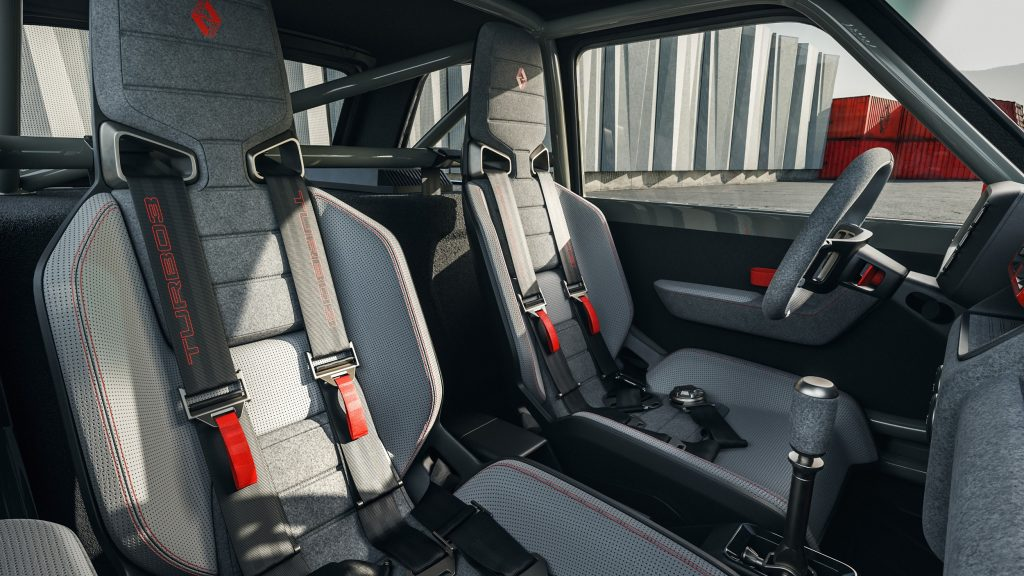 The gray-and-black interior and roll cage of a Legende Automobiles Turbo 3